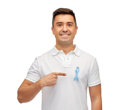 smiling man with prostate cancer awareness ribbon