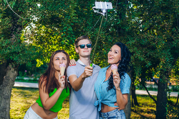 Group of friends taking picture themselves with monopod use