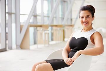 Mixed race Asian businesswoman relaxing, horizontal portrait