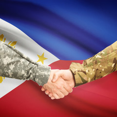 Men in uniform shaking hands with flag on background - Philippin