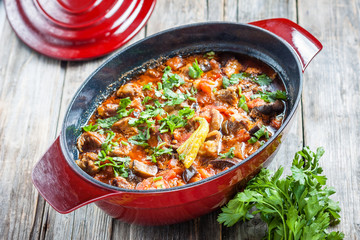 braised lamb with eggplant and vegetables in red pot