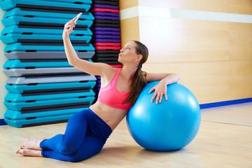 Pilates woman shoots selfie mobile self portrait