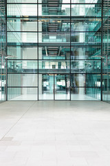 Empty, modern atrium of a large corporate business, vertical