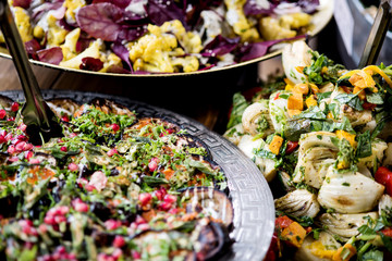 An assortment of salads on a buffet table
