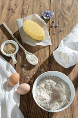 top view, ingredients to make a cake on a wooden table