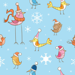 Vector seamless winter pattern with cute cartoon birdies in knitted caps on a blue background.