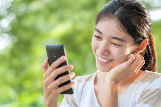 Asian woman looking smartphone