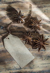 star anise on wooden background with blank label