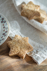 closeup, delicious shortbread placed on a napkin on a wooden tab