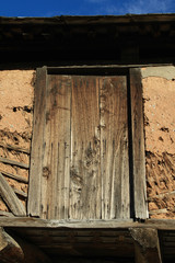 Old barn door suspended above the ground