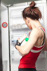 Woman near fridge