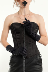 Woman holding a riding crop