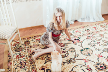 Beautiful Blonde Woman with Her Dog in a Beautiful Interior