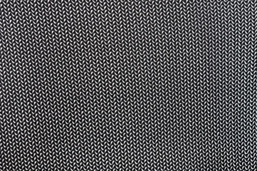 part of black fabric with a striped pattern