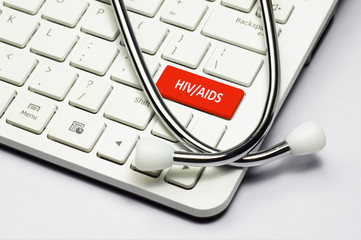 Keyboard, HIV/AIDS text and Stethoscope