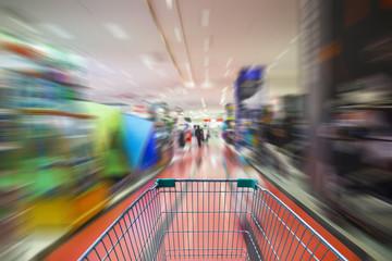 motion blur of supermarket cart in supermarket