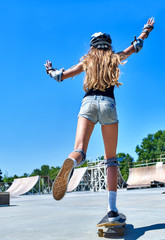 Teen girl rides his skateboard
