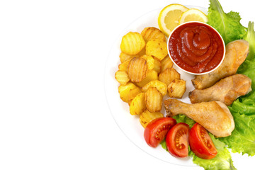 chicken legs on a white plate with slices of tomato and lettuce and french fries and ketchup top view isolated on white background