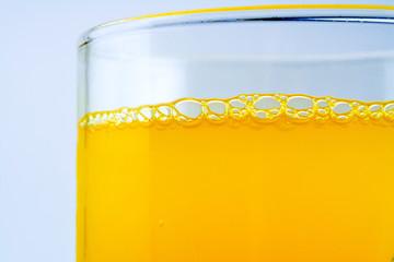 bubbles in an orange drink closeup