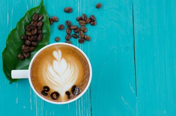 hot coffee with foam milk art 2016 pattern on wooden background