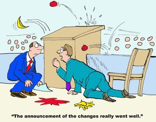 Business cartoon showing businessman crouching behind podium as audience throws rotten tomatoes at him.  Peer says, 'The announcement of the changes really went well'.