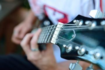 guitarist playing guitar closeup