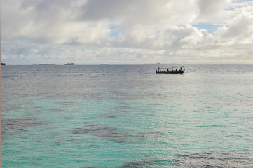 Maldivian  Traditional  local boat with Clear water, Maldives.