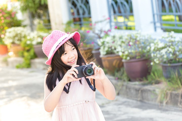 Little asian cute girl showing of camera and take a picture in p