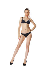 Full length portrait of a beautiful young model in black bikini