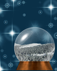 Snow globe with snowy winter landscape inside, on blue and white shiny winter holiday background.