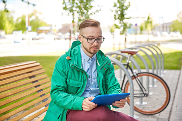 happy young hipster man with tablet pc and bike