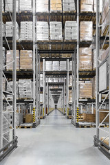 Huge distribution warehouse with high shelves