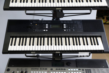 Synthesizers on stand in shop