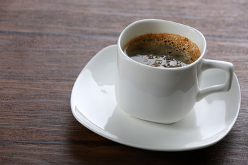 Cup of coffee on table close up