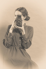Woman retro style with old camera