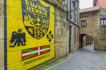 Narrow alley of the old town of Pasajes de San Juan  (Spain)