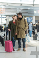 Young stylish couple in an airport about to take a plane