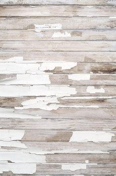 Old white paint peeling on wood texture