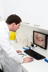 Dentist examining in monitor