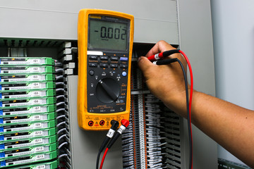 Digital multimeter checking voltage