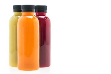 Fruit and vegetable juice bottles isolated on white background