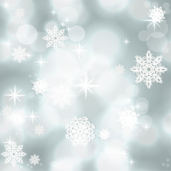 Blue shining seamless Christmas background with snowflakes