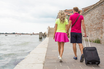 Couple walking with travel suitcase