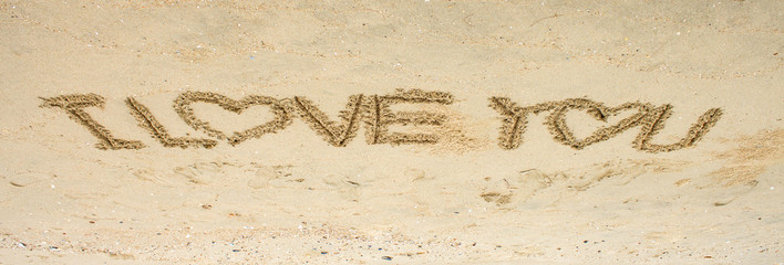 i love you text on sand