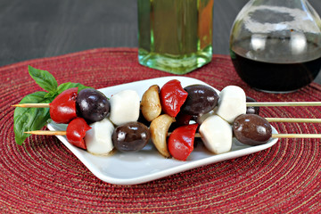 Antipasto  kabobs with olives, garlic, roasted peppers and mozza