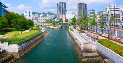 Downtown of Nagasaki city with city quay and canal river. Nagasaki City