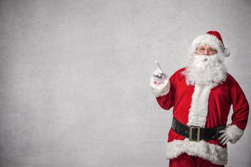 Santa Claus pointing on a wall Wall mural