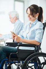 Confident business woman in wheelchair