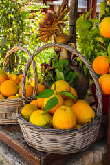 Full basket with ripe oranges