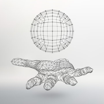 Ball on the arm. The hand holding a sphere. Polygon ball
